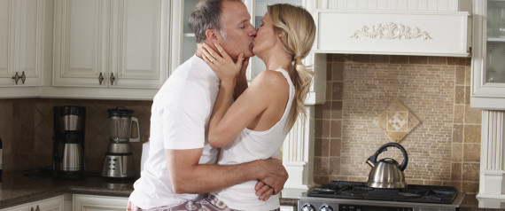 n-OLDER-COUPLE-KISSING-IN-KITCHEN-large570