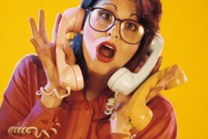 Woman handling too many phone calls