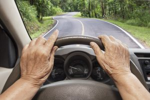 elderly person driving