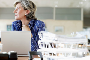 Woman at desk in office, low angle view