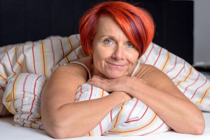 middle aged woman in bed