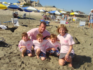 Andrea with her husband and three sons at a Breast Cancer Fundraising event