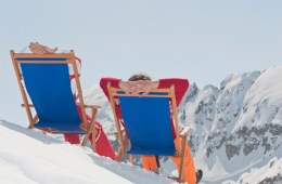 Austria, Salzburger Land, Couple sitting in deck chairs, rear view