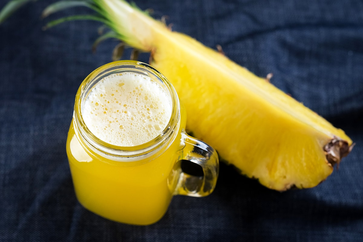 Pineapple and cup of pineapple juice