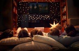 Family enjoying movie night during the holidays