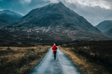 Woman walking towards mountains