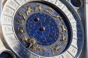 Golden zodiac astrological clock, sunlight and shadow