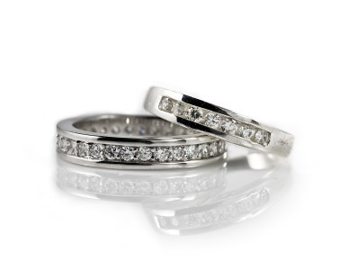 Two engagement rings on white background
