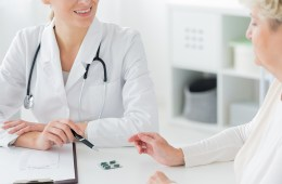 Doctor prescribing medication to patient
