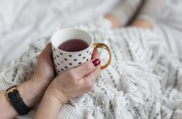 Woman relaxing at home with tea