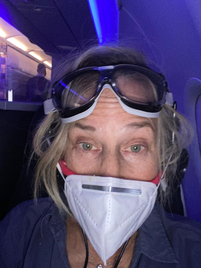 Wearing a mask and goggles on a plane
