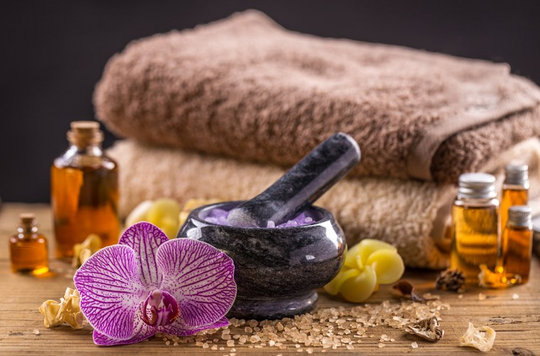 Spa concept of massage oil and towel