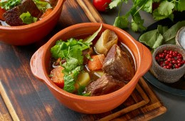 Goulash with large pieces of beef and vegetables. Slow stewing, cooking in two pot or cast-iron pan