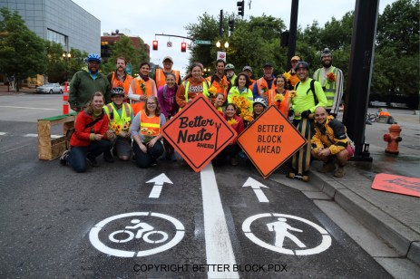 Volunteers holding signs in walk and bike lanes