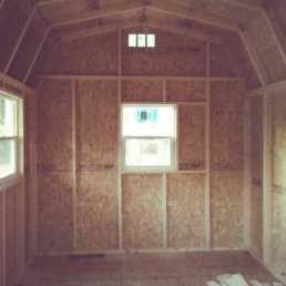 10x16x11 7'sidewalls Barn with 4x16 Porch incorporated into the rafters Inside