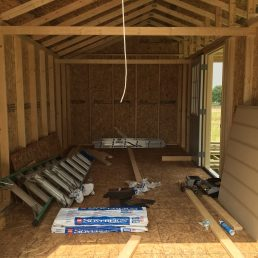 10x20x11 7'sidewalls Barn House with 4x20 Porch incorporated into the rafters Inside