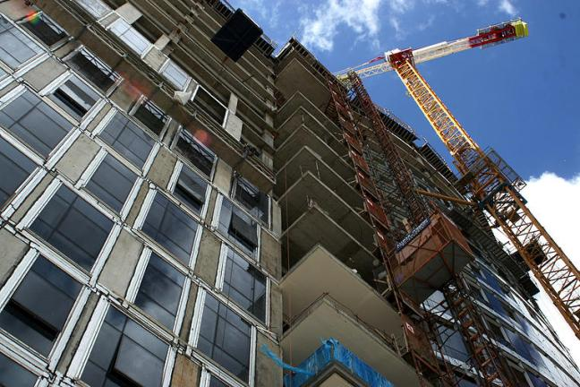 Simple rule of thumb - the more cranes and scaffolds, the more expensive the work. Be careful when buying a condo conversion.