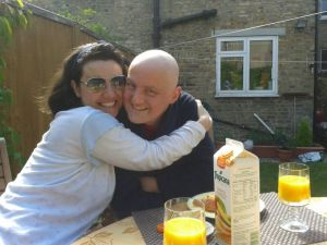 Mariacristina and George enjoying a sunny breakfast in the garden