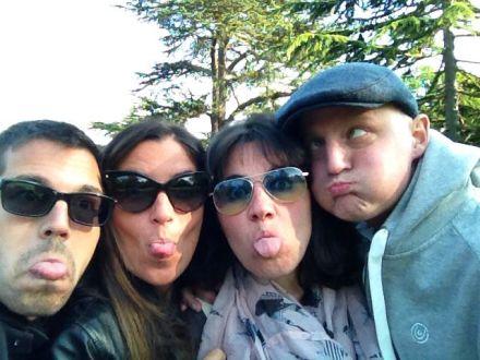 Three Italians and an Englishman posing