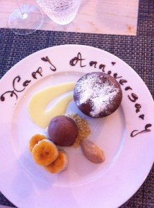 Pudding, with 'Happy Anniversary' written on plate