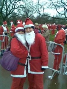 George and Mariacristina in Santa costumes for a fun run
