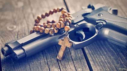 pistol and cross