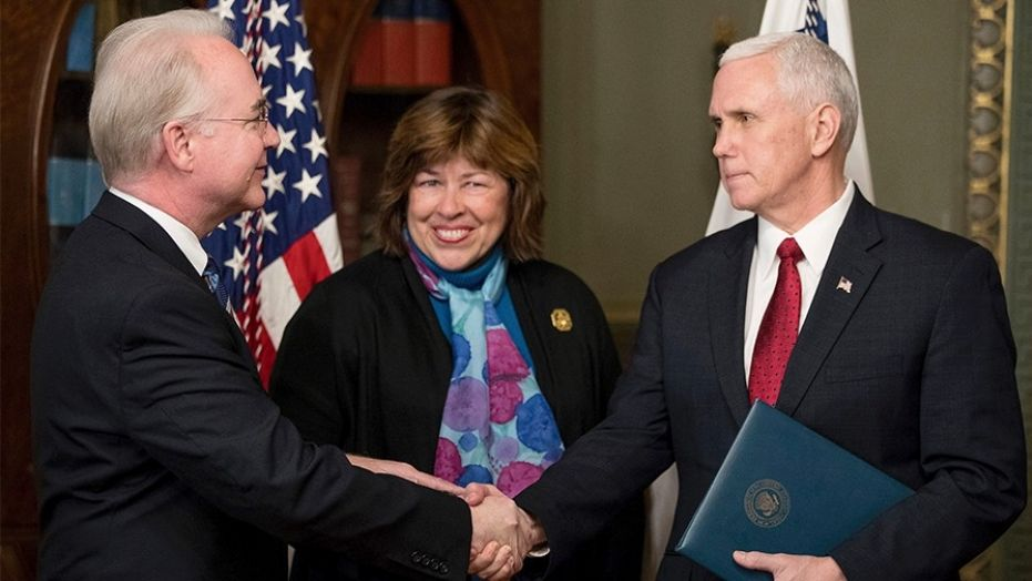 State Rep. Betty Price smiles at the camera as her husband, Tom Price, shakes hands with Vice President Mike Pence.