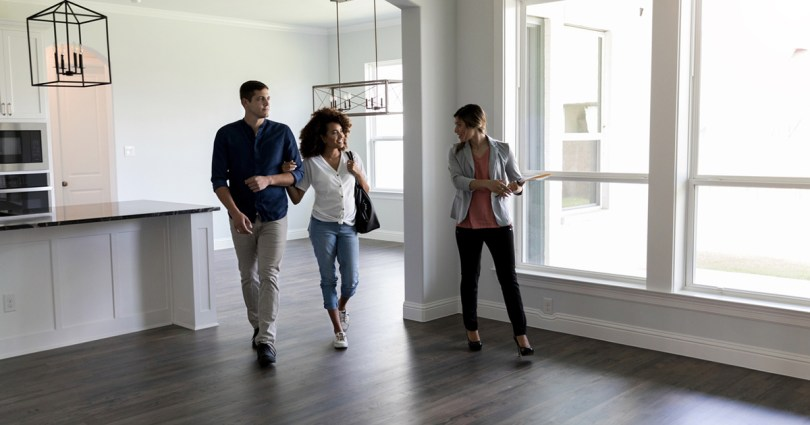 realtor showing a home to prospective buyers