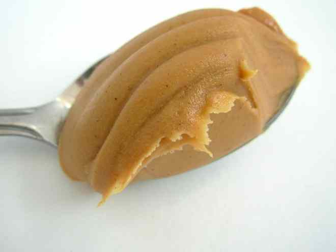creamy peanut butter on a spoon