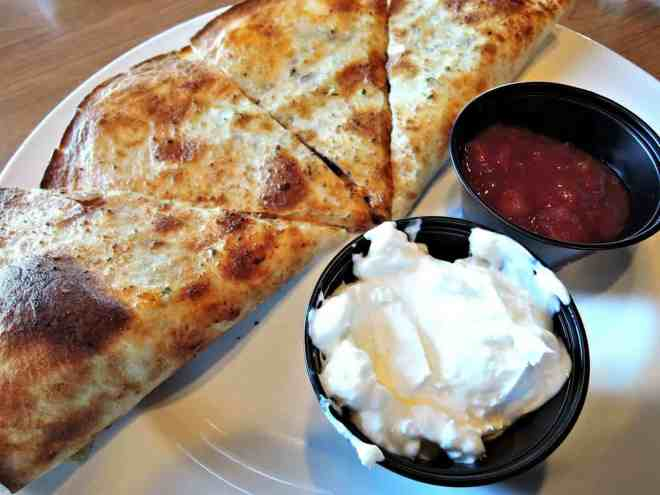 Quesadillas with sour cream and salsa