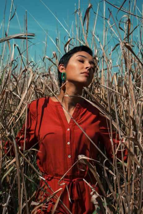 stylish woman standing in field