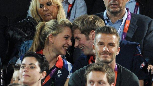 Laura and Jason Kenny look at each other with their foreheads touching