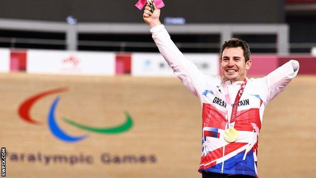 Jaco van Gass celebrates on the podium after receiving his gold medal