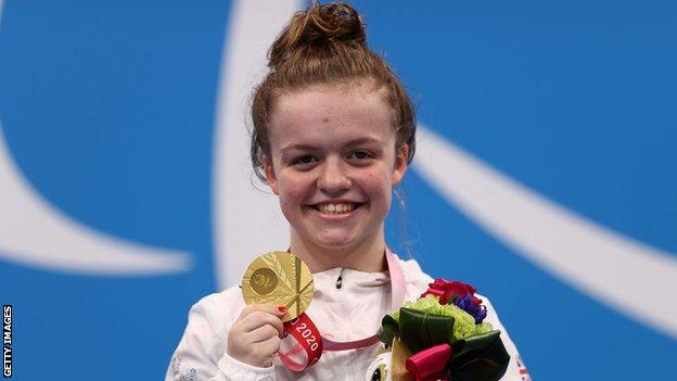 Maisie Summers-Newton shows off her gold medal in the S6 200m medley