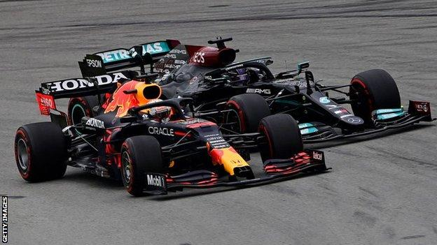 Max Verstappen and Lewis Hamilton on the racetrack at the Spanish Grand Prix