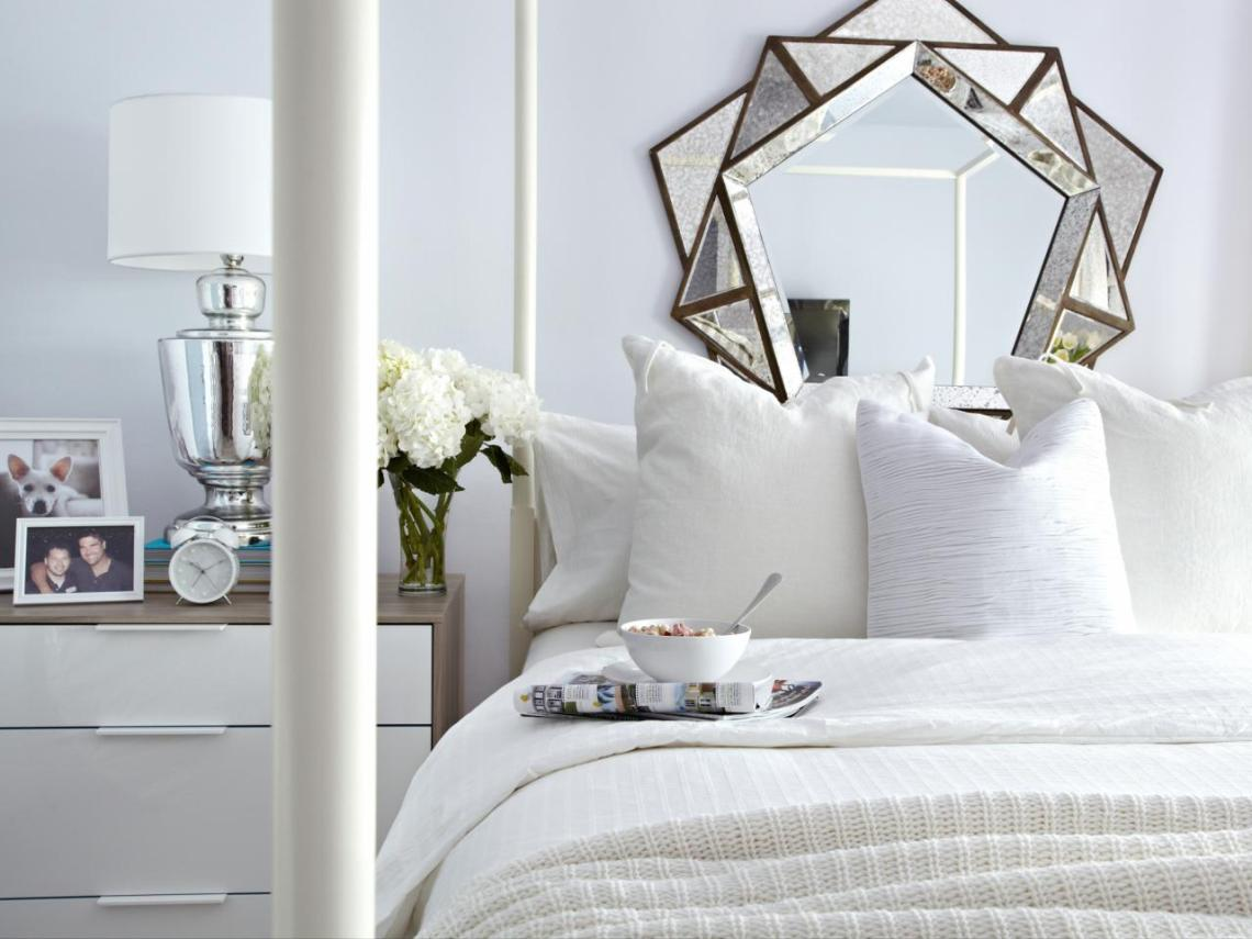 Comfy bed with white spread and pillows, breakfast tray on the bed.