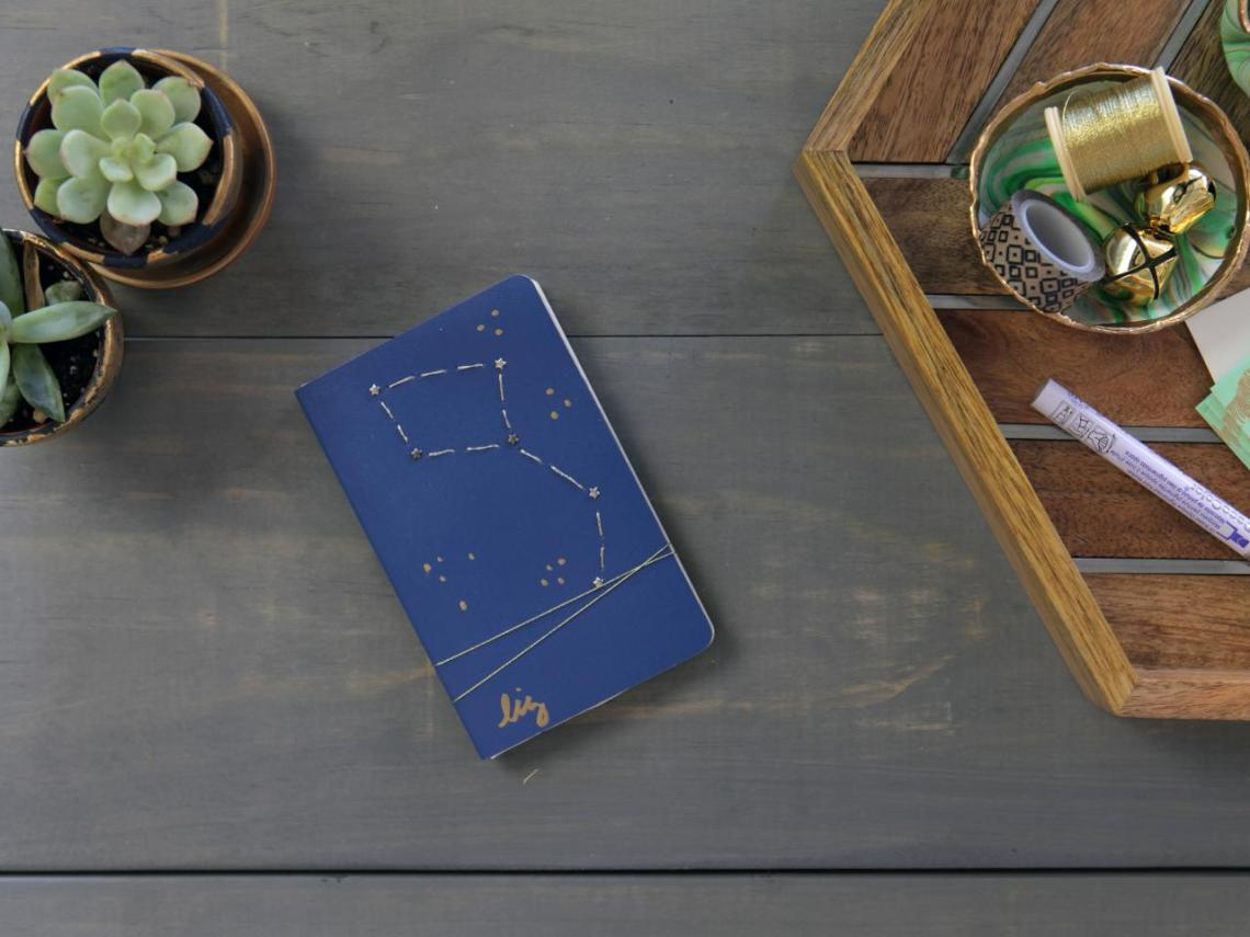 Blue notebook on grey wood table