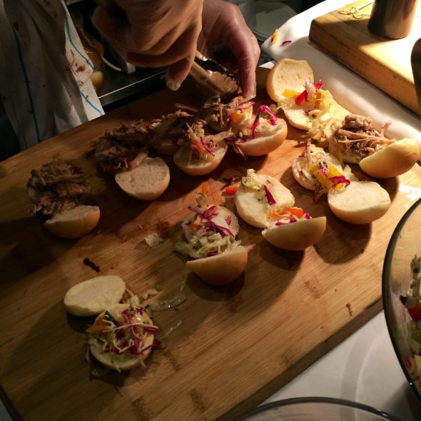 De Luca's porchetta sliders served with a rich and sweet blackberry BBQ sauce.