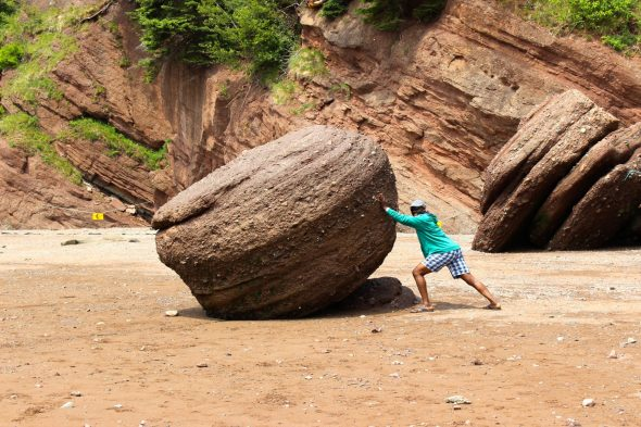 Pushing rocks in New Brunswick.