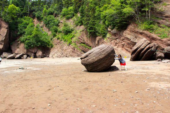 Pushing rocks in New Brunswick.