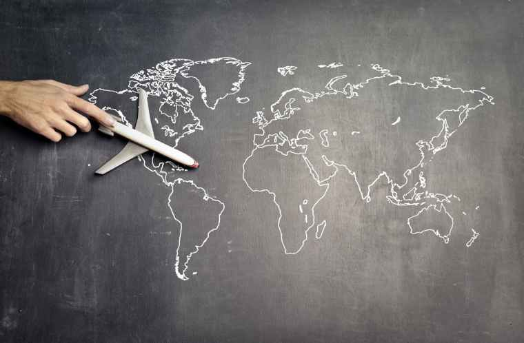 miniature airplane and hand of person over drawn map: Photo by Andrea Piacquadio