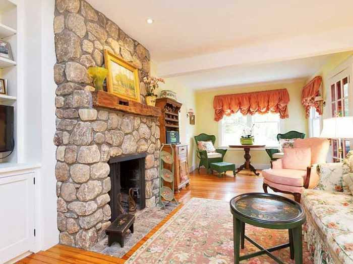 Cottage Living Room with Fieldstone Fireplace