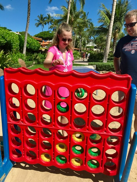 Playing Connect Four on the beach at Disney's Aulani