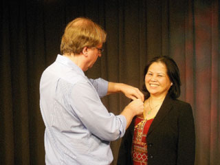 Kim Allyn mics up Ha Tran before her taping session