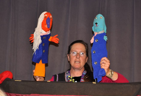 Amy Seabrook with two of her puppets gets ready to start the show