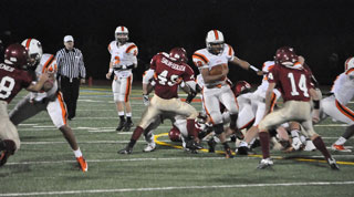 The Beverly High football team executes an offensive play during a recent game