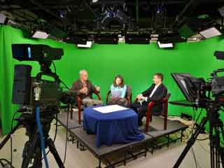 Jason Parisella talks solar power with Doug Turner and Jenn Parisella