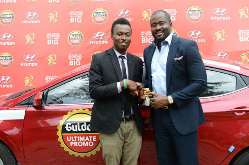 Desmond Elliot, presenting the keys to a brand new Hyundai Elantra to Chibueze Gift Chukwuoti, winner of the Gulder Ultimate Promo via a raffle draw recently held in Port Harcourt