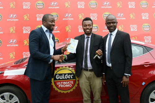 Desmond Elliot, Emmanuel Agu, Marketing Manager, Gulder, More, 33, Life and Stout category, Nigerian Breweries Plc during the prize presentation for raffle draw winners in the ongoing Gulder Ultimate Promo at NB headquarters in Lagos, presenting the keys to a brand new Hyundai Elantra to Chibueze Gift Chukwuoti, winner of the Gulder Ultimate Promo via a raffle draw recently held in Port Harcourt