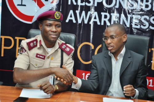 """L-R Lagos Sector Commander, Federal Road Safety Commission, Mr. Hyginius Omeje, and MD/CEO, Guinness Nigeria, Peter Ndegwa  at the flagoff of the Guinness sponsored """"Ember Months Responsible Drinking Awareness Campaign"""" in Lagos"""